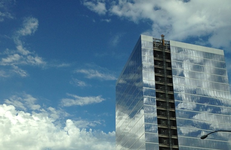 High-rise building reflecting clouds